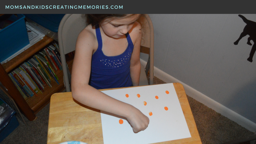 A Doing her thumbprints by herself