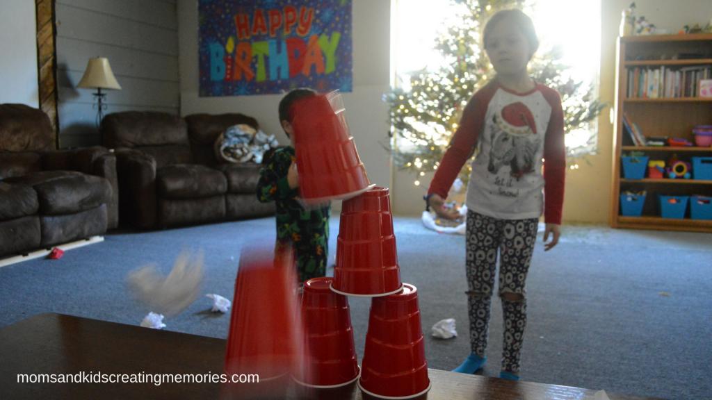 "Easy After Christmas Activities - using the ""snow""balls to knock down a tower"