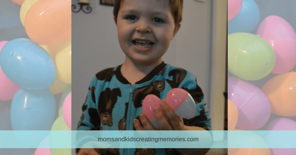 10 Fun Things to do with Easter Eggs - my son holding up an egg that he had connected to another egg