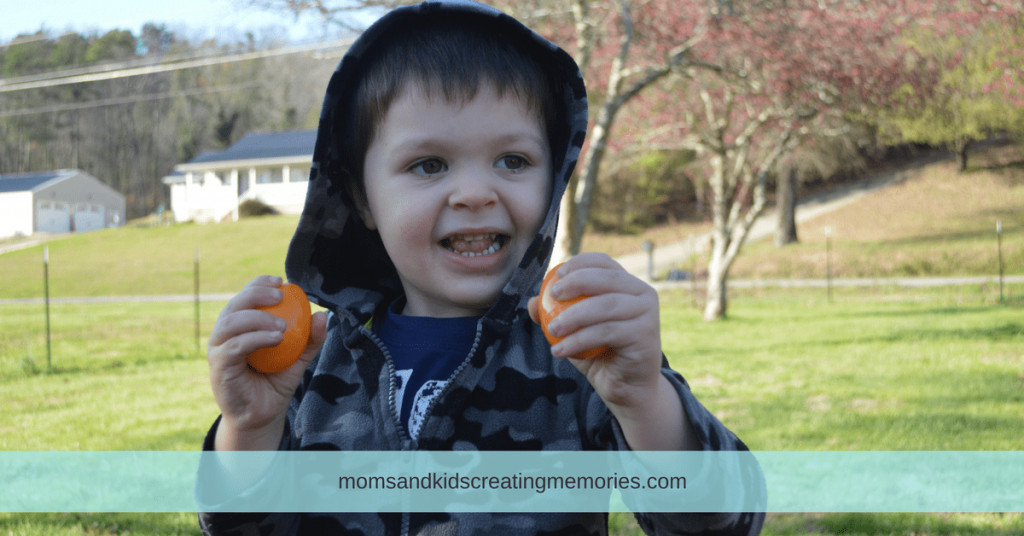 10 Fun Things to do with Easter Eggs - My son shaking his eggs with rocks in them
