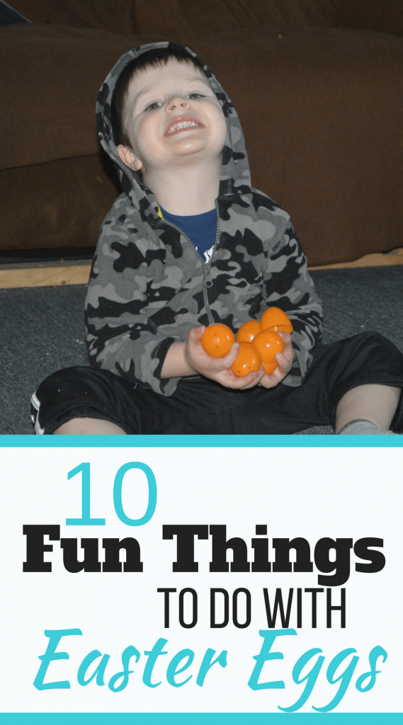 10 Fun Things to do with Easter Eggs - My son holding on to a handful of orange Easter eggs
