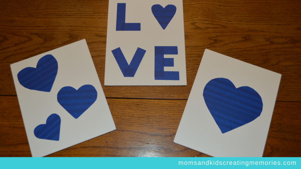Canvas Art - Painters Tape in a design on the canvas - hearts and the word Love