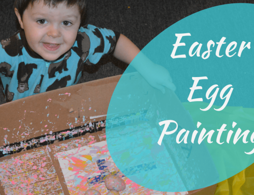 Easter Egg Painting - My son shaking Easter eggs back and forth in the box over the page with paint