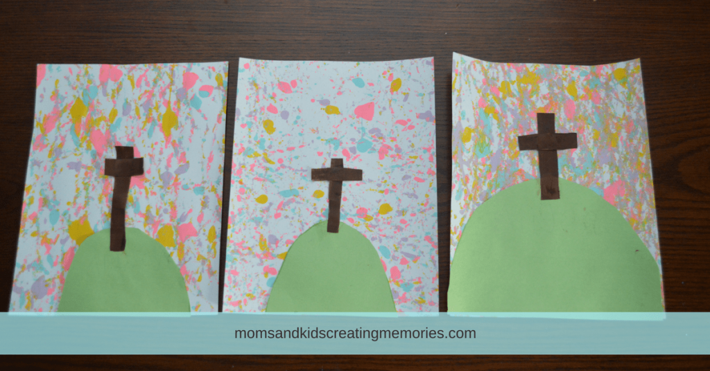 Easter Egg Painting - construction paper hill and cross added on to the painting