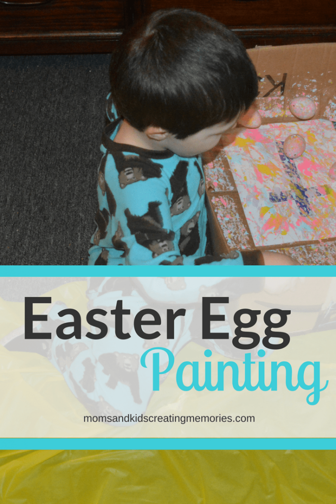 Easter Egg Painting - S shaking Easter eggs back and forth in the box over the paper with paint on it