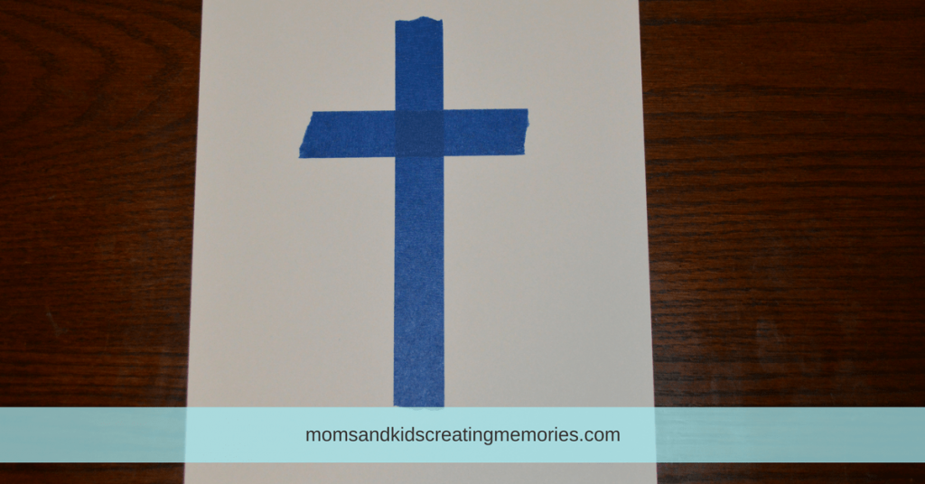 Easter Egg Painting - White Cardstock with Cross made out of Painter's Tape on it