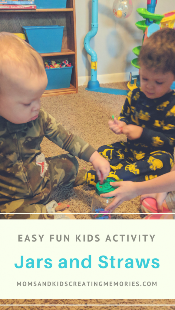 My boys putting the straws in the jar - with text overlay - Easy Fun Kids Activity Jars and Straws