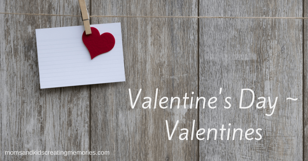Valentine's Day - Wood background with a clothespin holding a heart and a piece of paper with the text overlay Valentine's Day ~ Valentines