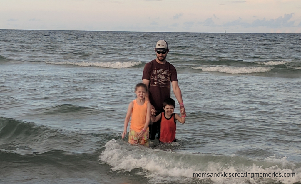 My husband and two of my kids in the ocean while on vacation.