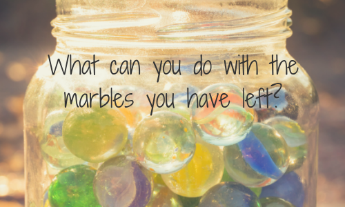 Jar filled with marbles with text overlay - What can you do with the marbles you have left?
