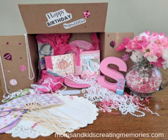 Party Box with all the supplies for a tea party with Happy Birthday Susanna on it